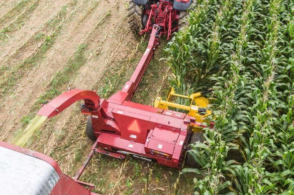 Pull behind harvester with Horning kernel processor and 2-row rotary corn head